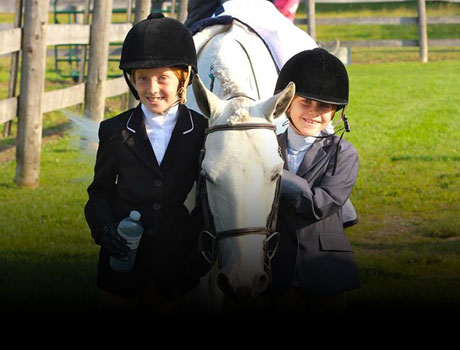 Two happy Stonewood Riding Academy students with their horse after a horseback riding competition in Pickering, Ontario.